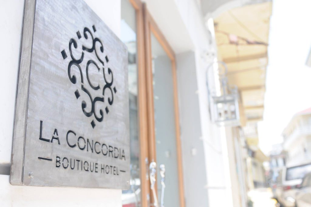 Sign by the entrance of La Concordia Boutique Hotel