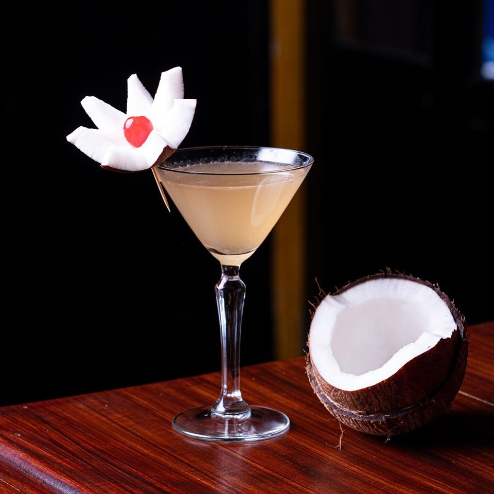 Fresh coconut cocktail with coconut decoration with a cherry