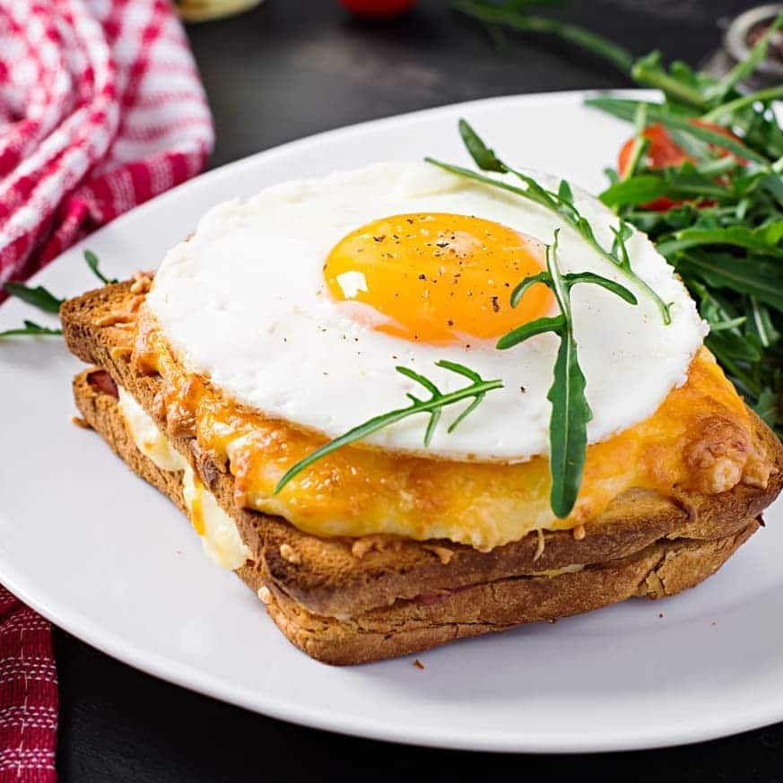 Croque Madame includes egg bread, Emmental cheese, cooked ham with a fried egg and bechamel sauce.