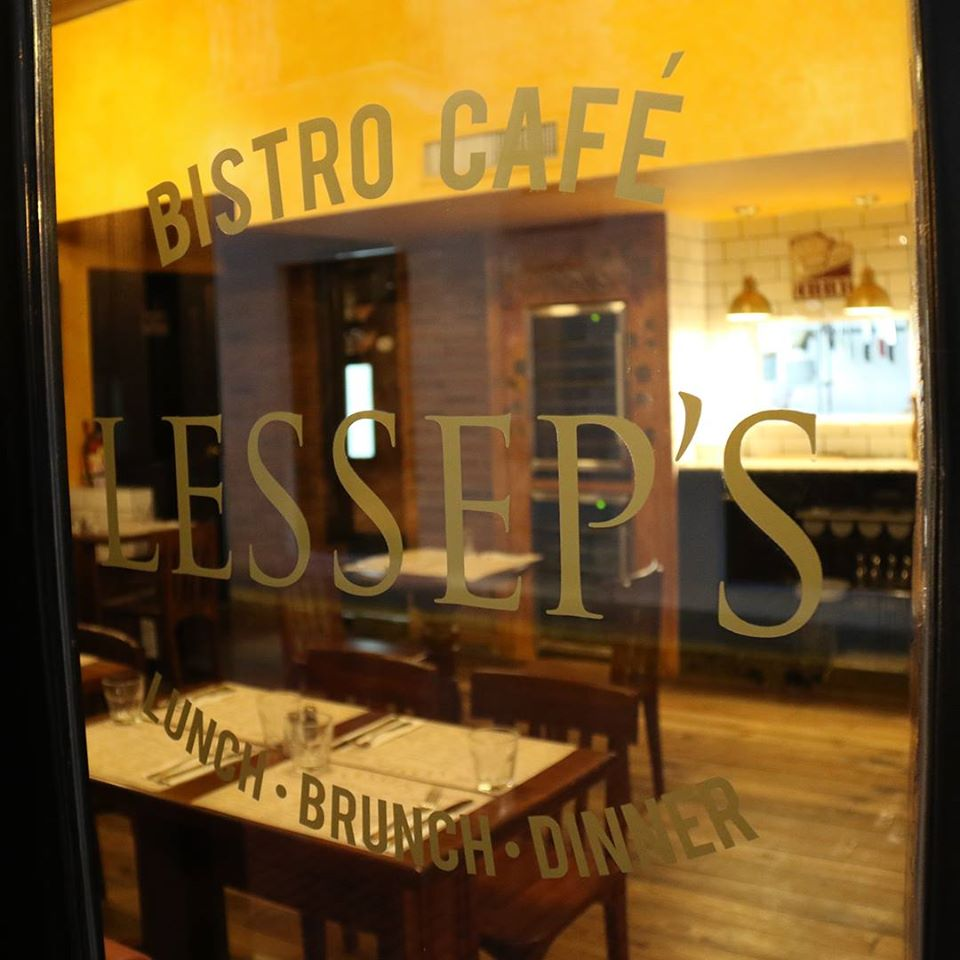 View from outside to inside of Lesseps Bistro Cafe restaurant