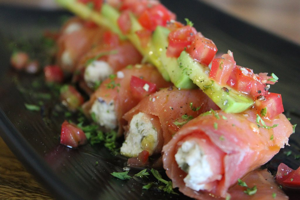 Smoked salmon rolls with avocado and tomato