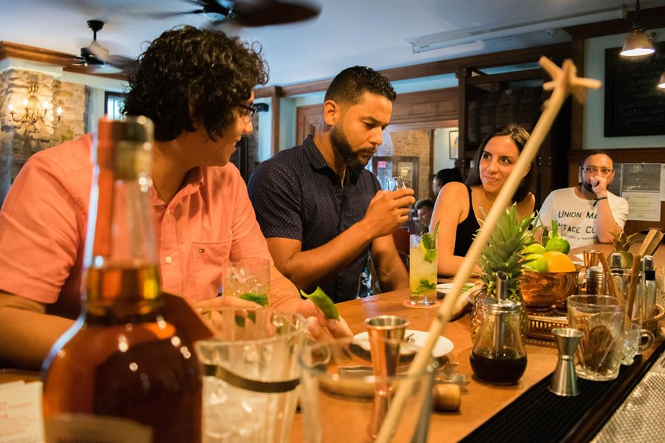 Clients tasting rum and cocktails at Pedro Mandinga Rum Bar