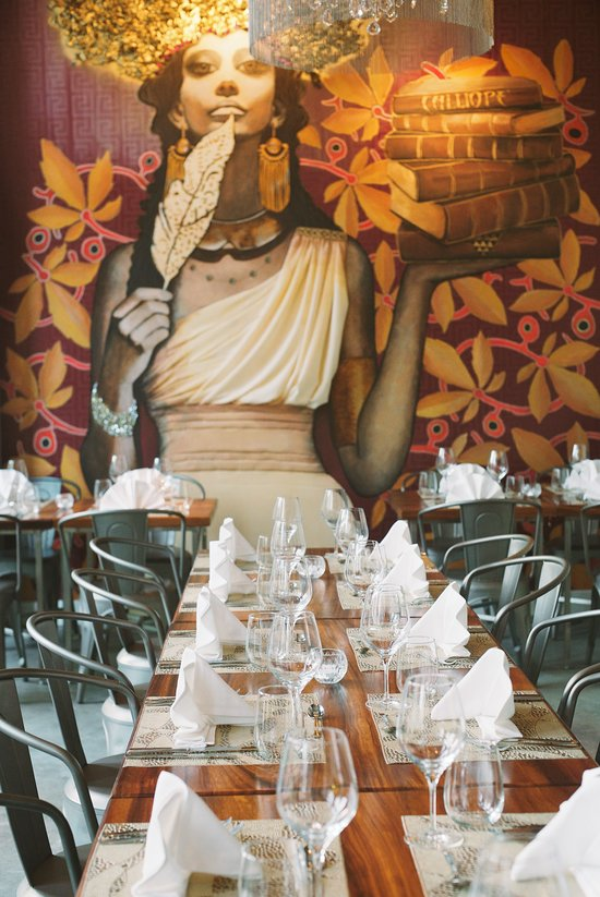 A mural of the Muse Caliope decorates the wall of the Caliope Restaurant