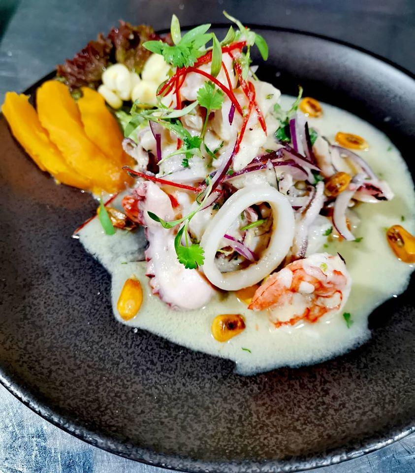 Matador ceviche with shrimp, octopus, squid, corvina, red onion, coriander, leche de tigre sweet potato, cancha and corn