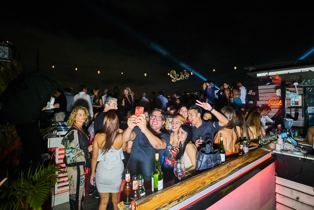 People partying at Gatto Blanco Rooftop Bar in Casco Viejo Panama