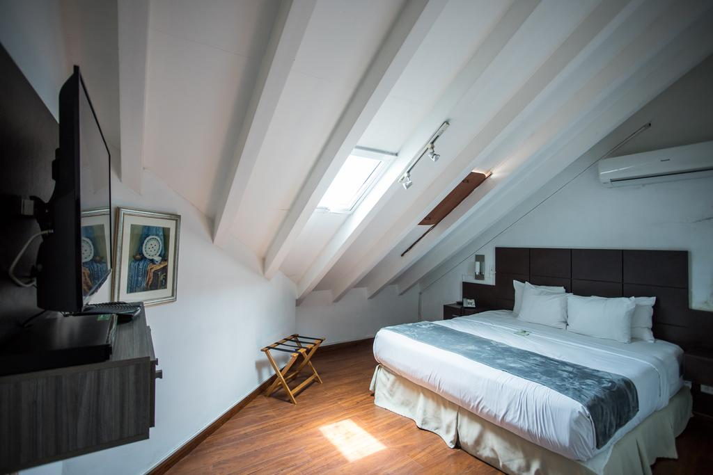 Rooms are smaller and located in the attic off Casa Antigua Hotel