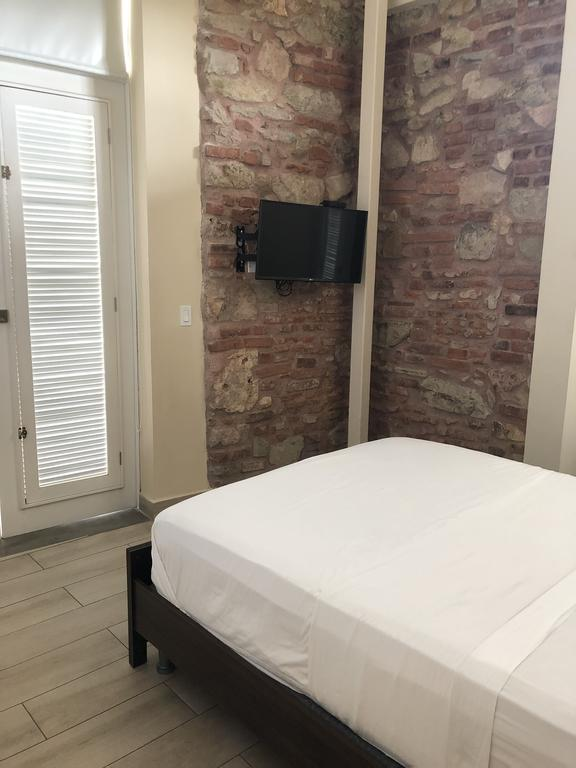 Rooms at Casa Franco are quite simple with a queen bed and television