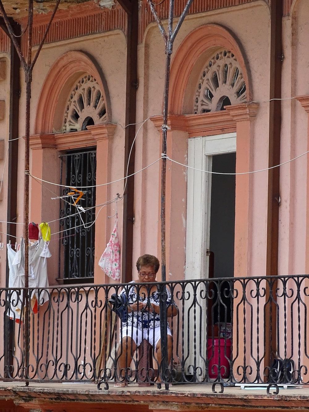 woman sitting on her balcony in Casco Viejo Panama