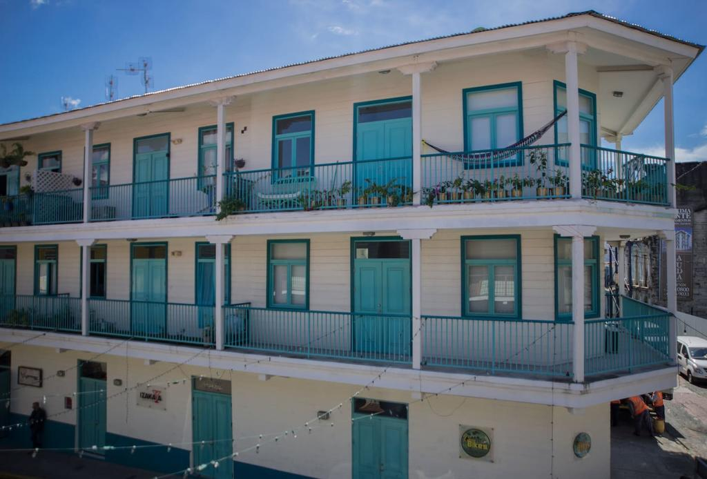 Flor de Lirio is an Antillean style building that is white with turquoise in Casco Viejo