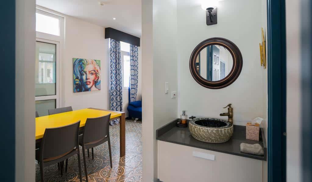 Bathroom sink and living room of apartment 1A in Flor de Lirio  in Casco Viejo