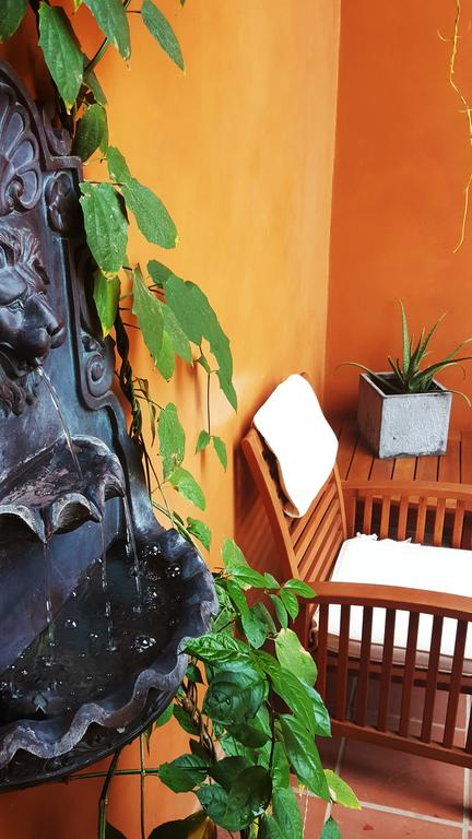 chair and fountain in the courtyard of La Isabela Suites