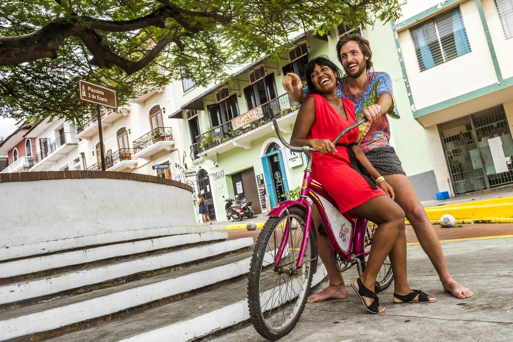 couple in a bicycle of Lunas Castle Hostel