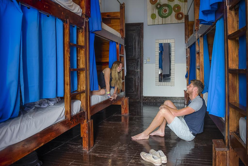 two guests in the dormitories of Lunas Castle Hostel