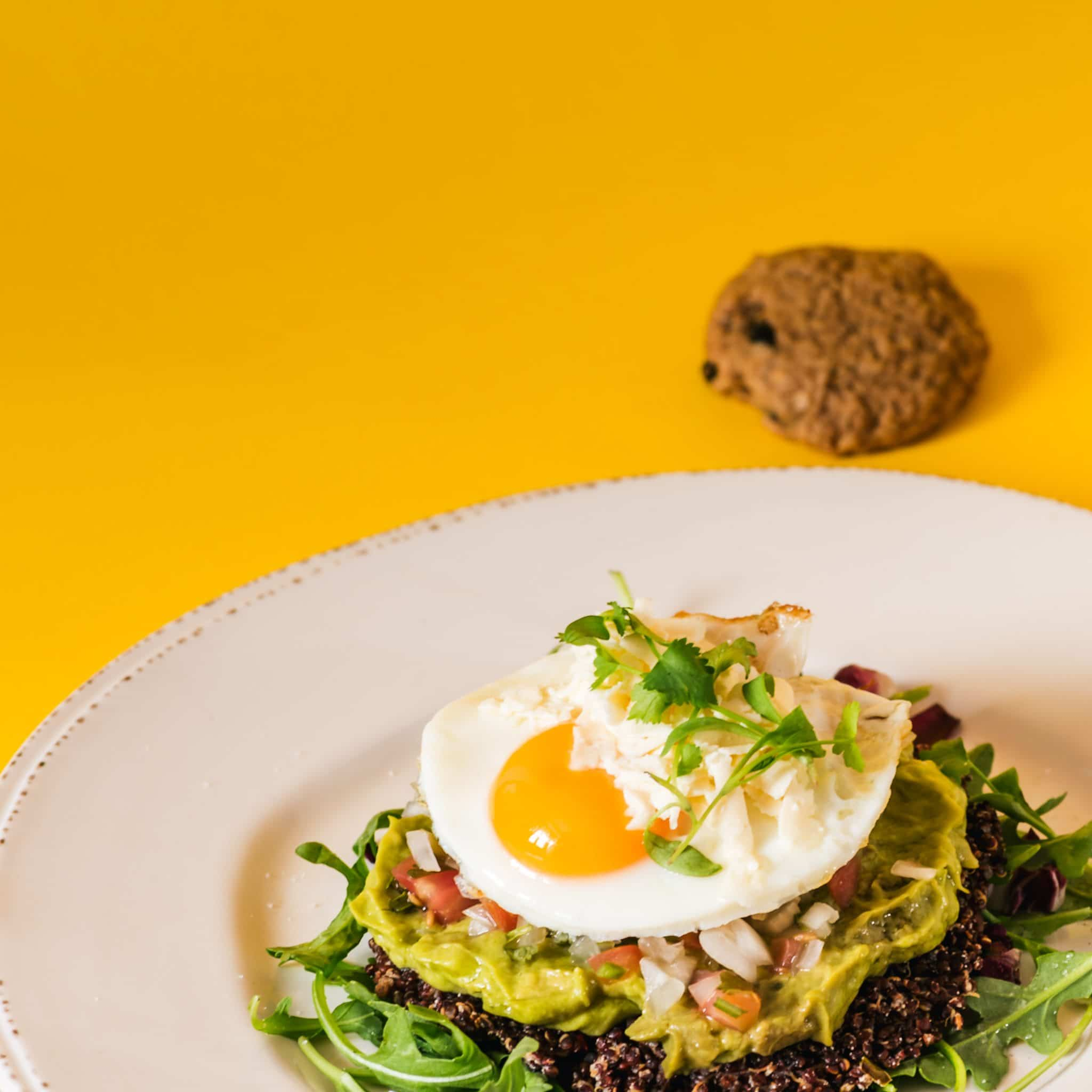 Eggs with quinoa, guacamole and picadillo