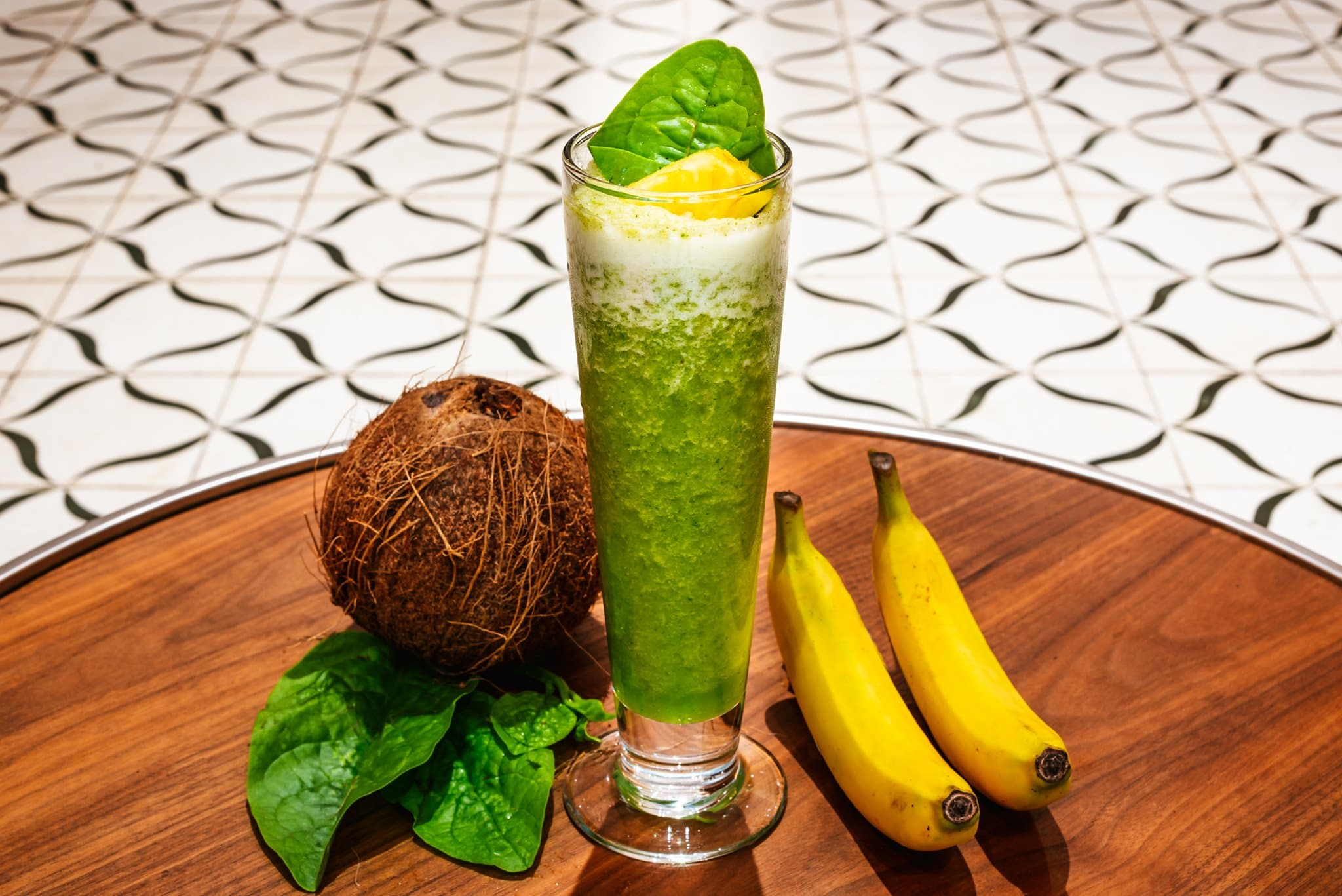 Coconut, banana, spinach and pineapple smoothie