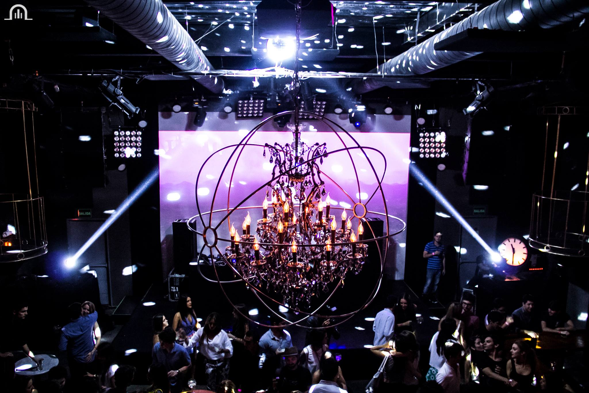 There is a giant chandelier in the center of the dance floor at Teatro Amador