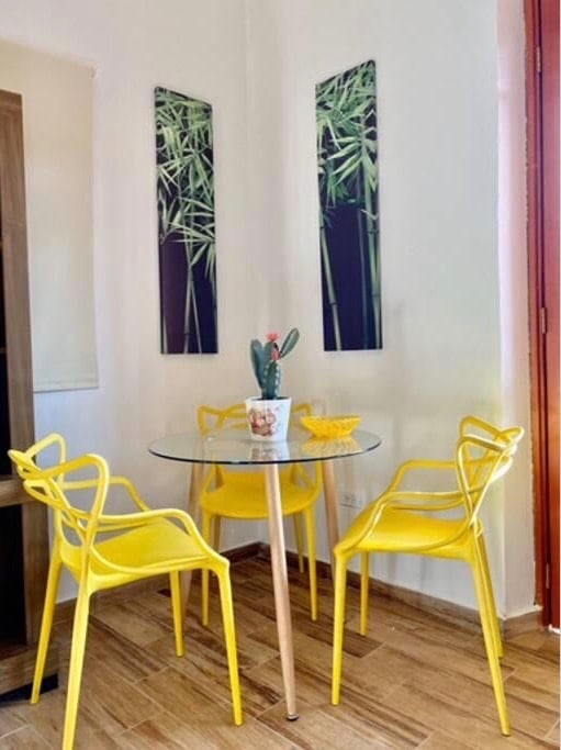 dining table with yellow chairs in Vive Casco Antiguo in Casa Santana