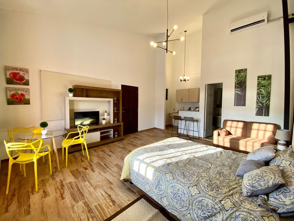 Suite of Vive Casco Antiguo in Casa Santana with dining table, sofa, bed, and kitchen